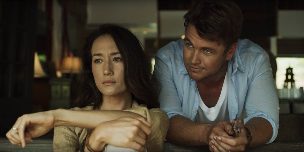 "(L-R) Maggie Q as Christine and Luke Hemsworth as Neil in the horror / thriller, ""DEATH OF ME,"" a Saban Films release. Photo Courtesy of Saban Films."
